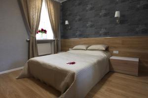 Кровать или кровати в номере Апарт-Отель Голицына 19
