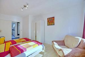 Ein Bett oder Betten in einem Zimmer der Unterkunft Ferienwohnung in der Mengstraße