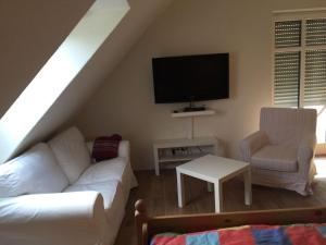 Ein Sitzbereich in der Unterkunft Huus Windroos  Wohnung 2
