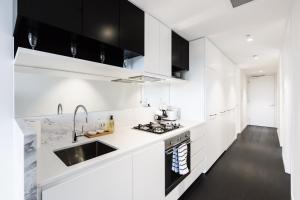 A kitchen or kitchenette at Esther - Beyond a Room Private Apartments