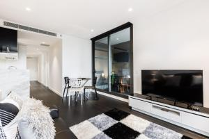 A television and/or entertainment center at Esther - Beyond a Room Private Apartments