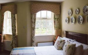 A bed or beds in a room at Rathmullan House Hotel
