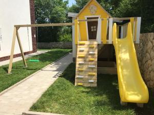 Children's play area at Villa Apartments Futura