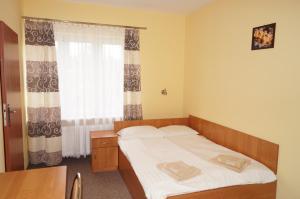 Łóżko lub łóżka w pokoju w obiekcie Hotel-Restauracja-Bar Rudka