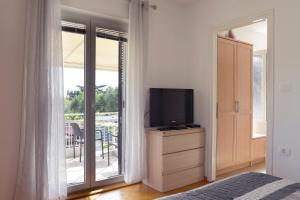 A television and/or entertainment center at Apartments and Rooms Oražem Zoro