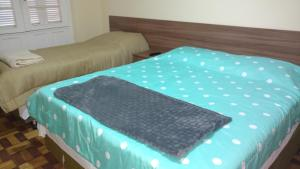 A bed or beds in a room at Lotus Hotel & Hostel