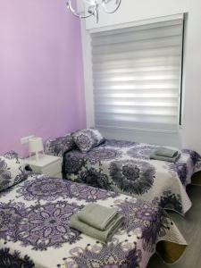 Cama o camas de una habitación en La Casa Luna