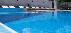 The swimming pool at or near Ema Hotel