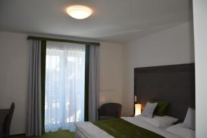 Postel nebo postele na pokoji v ubytování Nobless Resort