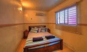 A bed or beds in a room at Kurrimine Beach Holiday Park