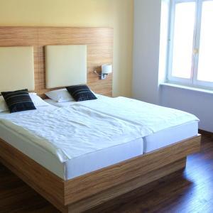 Ein Bett oder Betten in einem Zimmer der Unterkunft Appartementhaus am Dom