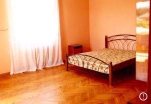 Кровать или кровати в номере Country House on Babusharskaya
