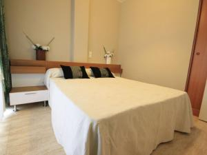 A bed or beds in a room at Apartment Solmar