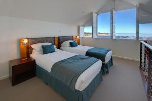 A bed or beds in a room at Mantarays Ningaloo Beach Resort