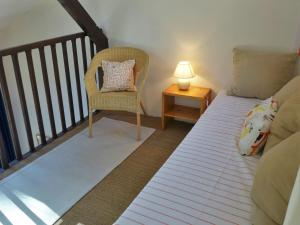 A bed or beds in a room at Holiday Home Golf de l'Ardilouse
