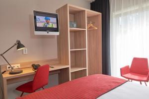 Télévision ou salle de divertissement dans l'établissement Prinsenhotel