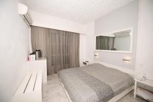 Ліжко або ліжка в номері Porto Castello