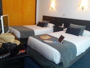 Letto o letti in una camera di Hotel Miramar