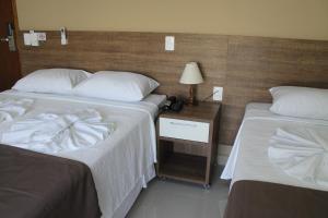 Cama ou camas em um quarto em Avare Plaza Hotel Plus