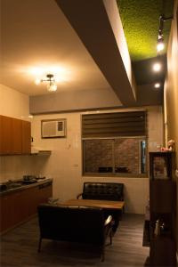 A kitchen or kitchenette at My Second Floor Homestay