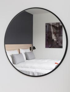 Кровать или кровати в номере Citybox Bergen