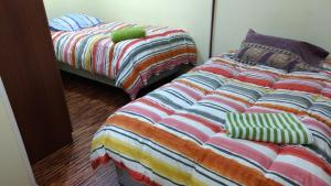 A bed or beds in a room at Hospedaje Familiar