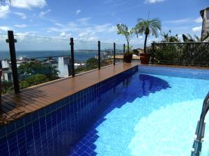 The swimming pool at or near Hotel Casa do Amarelindo