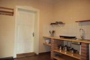 A kitchen or kitchenette at Apartmán Carpe Diem