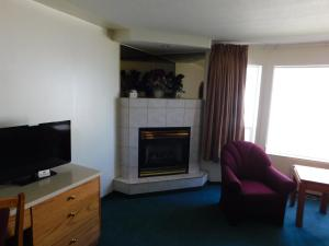 A television and/or entertainment center at Western Budget Motel #1 Leduc/Nisku
