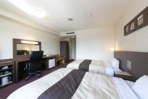 A bed or beds in a room at Ise City Hotel Annex