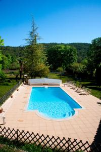 The swimming pool at or near Domaine De La Provenç'âne