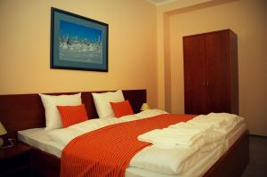 A bed or beds in a room at Hotel Podhradie