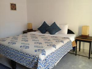 A bed or beds in a room at Seventh Heaven inn Rishikesh