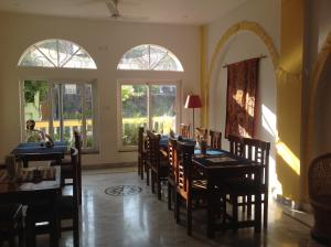 A restaurant or other place to eat at Seventh Heaven inn Rishikesh
