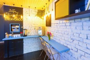 A kitchen or kitchenette at Loft Hotel H11