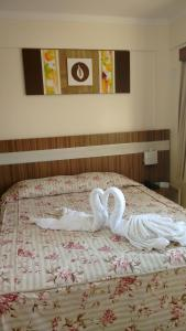A bed or beds in a room at Flats Lacqua Diroma