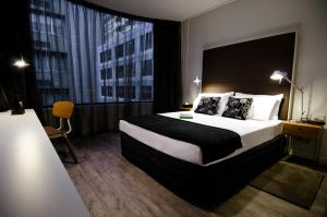 A bed or beds in a room at Ovolo Laneways