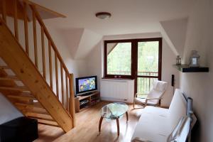 A seating area at Apartment Tatranská Kotlina