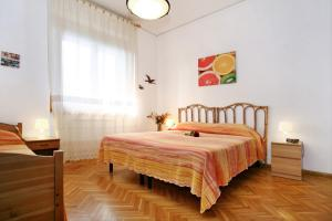 A bed or beds in a room at Appartamento Rialdoli