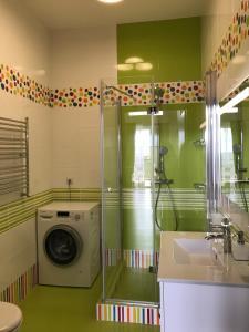 A bathroom at Apartment Imeretinskiy