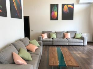 A seating area at Apartment Imeretinskiy