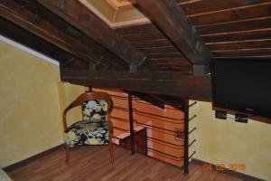 Un televizor și/sau centru de divertisment la Vila Romeo And Juliet