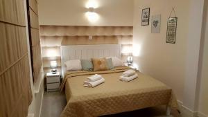 Łóżko lub łóżka w pokoju w obiekcie Central Park Apart