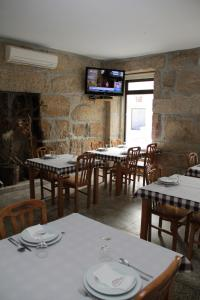 A restaurant or other place to eat at Residencial Parque