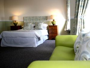 A bed or beds in a room at The Royal Hotel