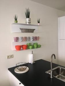A kitchen or kitchenette at Maison d'O