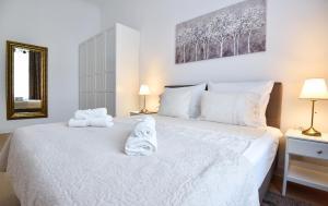 Кровать или кровати в номере Marulic Square Garden