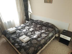 Кровать или кровати в номере Sofrino Park Hotel
