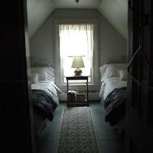 A bed or beds in a room at Estabrook House Bed and Breakfast