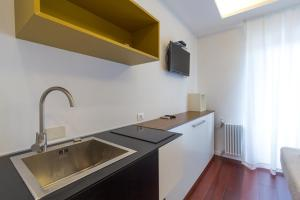 A kitchen or kitchenette at Relais Star of Trastevere